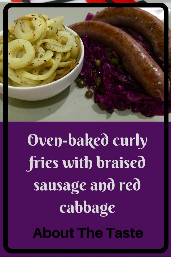 Oven-baked curly fries with braised sausage and red cabbage